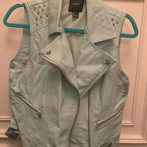 Light blue leather vest with studs